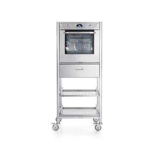 Column with a multifunction cold-door electric oven, one drawer and two pull-out stainless steel shelves. Entire unit on wheels.