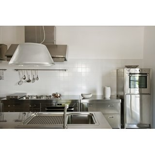 Column with a multifunction cold-door electric oven, stainless steel panel for dishwasher or refrigerator.